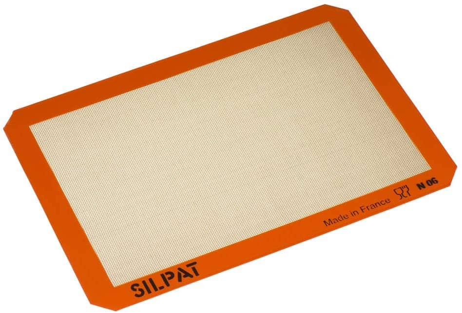 Orange and tan silicone baking mat