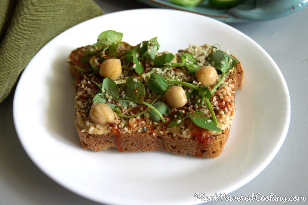 Close-up of oil-free hummus on toast with microgreens