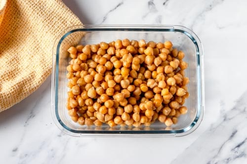 Cooked chickpeas in a shallow glass dish