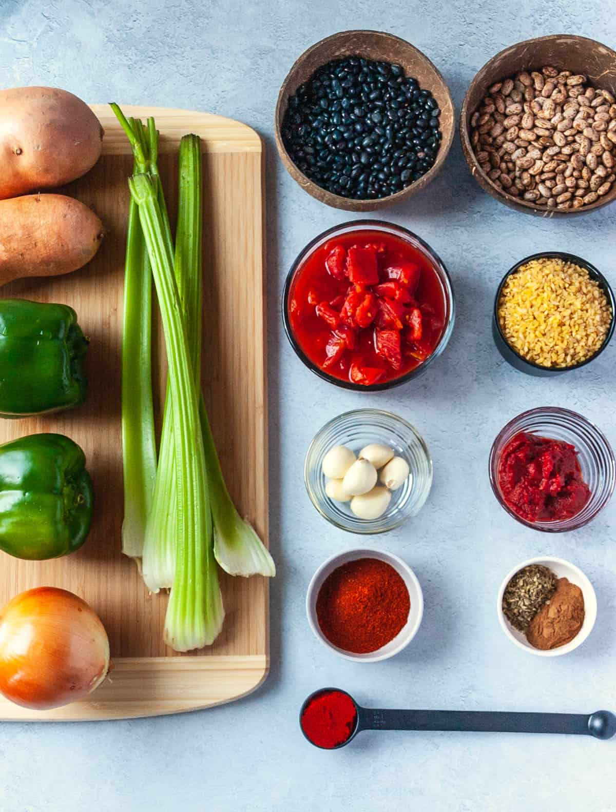 Ingredients needed to make Instant Pot dried bean chili arranged on a countertop