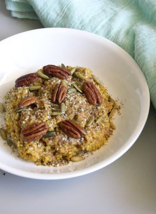 Bowl of steel cut oatmeal made in an Instant pot and topped with nuts and seeds